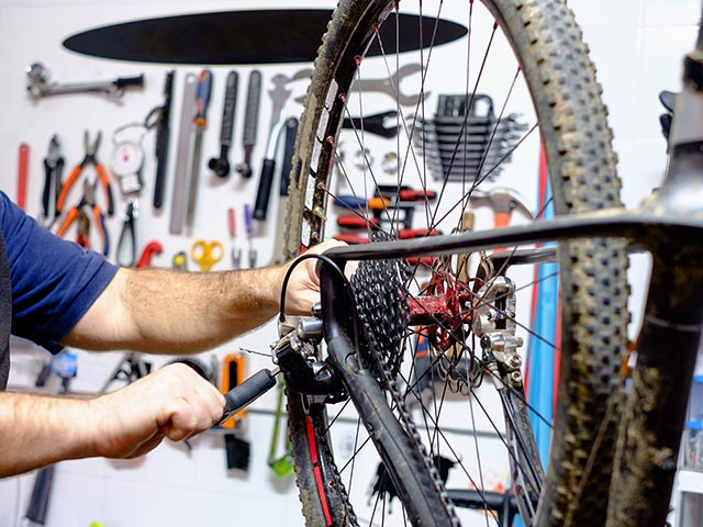 Bicycle,Mechanic,In,A,Workshop,In,The,Repair,Process